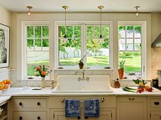 Love all the windows in this cute cottage kitchen. So sunny and bright. And big old fashioned kitchen sink. Window Over Sink, Kitchen Sink Window, Dark Kitchen Cabinets, Big Kitchen, Kitchen Redo, Kitchen Tips, Kitchen Ideas, Grey Kitchens, Cool Kitchens