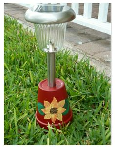 ......paint a clay pot, add a solar lite....done...