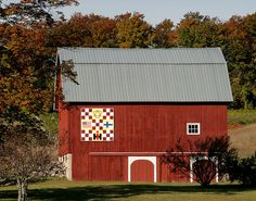 The Lehto's 1912 barn is on 15793 Smokey Hollow Rd. The barn was built In 1912. Suzanne designed the quilt to express who they are. The symbol at the top shows their Christian faith. The American flag, their pride of citizenship, the Finnish flag, their heritage, and the I for International Harvester, as in Tractor. Carl feels he is a farmer at heart.