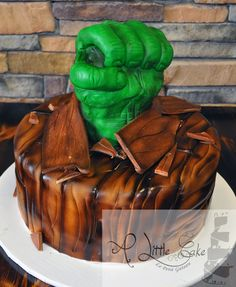 Incredible Hulk cake made up of chocolate  fresh rasberries. The cake has hulk theme  looks like wooden floor  hulk fist breaking out of it. #GroomsCake