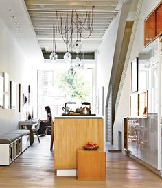 The couple has a large collection of cookbooks. To provide storage for them in the kitchen—and also seating—Sawatzky topped narrow bookca...