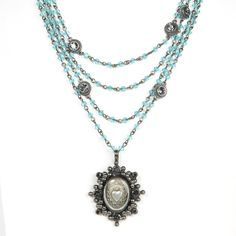 The Magdalena has been a VSA Classic as it is most versatile in style Wear open and long or layered The turquoise beads are reminiscent of sandy white beaches & Carribean oceans -Plated Bronze -Medallion is covered with a resin finish & is detachable - Length 12.5-14.5 inches plus medallion -Toggle Closure - Faceted Bicone crystals beads that add a POP of color -Handmade in San Miguel Allende Turquoise Water, Turquoise Beads, Turquoise Necklace, Crystal Beads, Crystals, White Sand Beach, Sacred Heart, Beaches, Color Pop