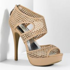Hubby Bought me these in Black.... I love them and they zip in the back......vera wang heels