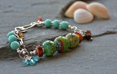 https://flic.kr/p/Sdn1rT | the three sisters by ruby acorn | the three sisters by ruby acorn  lampwork glass beads - loupiac de gatteville  lampwork glass discs - leese mahoney  amazonite, apatite faceted nuggets, fancy jasper faceted rounds, sunstone faceted rondelles, citrine rondelles, sterling silver hook and eye clasp, sterling silver links, sterling silver chain, sterling silver spacers, sterling silver jump rings, sterling silver crimp covers, antique sterling silver headpins…