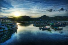 I don't think many people leave Hong Kong to come visit Lamma Island, but it is a nice jaunt. There is a nice hiking path around the island and it ends at this little harbor. There's lots of food and the reflections around sunset are a treat. - Hong Kong, China - Photo from #treyratcliff Trey Ratcliff at http://www.StuckInCustoms.com