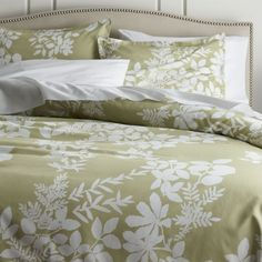 "This graphic botanical print by Fujiwo Ishimoto scatters realistic silhouettes in white on fresh spring green. Made of super-soft cotton, these beautiful bed linens can be paired with matching sheet sets for an inviting bed of greenery.  Duvet covers close with buttons and include interior ties to secure an insert.  Shams have a one-inch flange with a back flap enclosure. <a href=/down-duvet-insert/f10921>Duvet inserts</a> and <a href=""/bed-and-bath/bed-pillows/1"">bed pillows</a> also…"