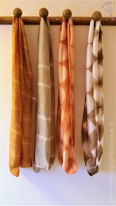 Silk scarves by Townhill Studio naturally dyed and shibori stitched and clamped.