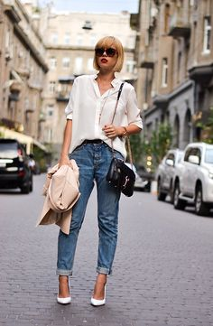 Perfect white button down paired with boyfriend jeans and pumps.