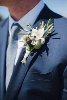groom boutonnieres - photo by Cambria Grace Photography http://ruffledblog.com/italian-marbling-inspired-beach-wedding