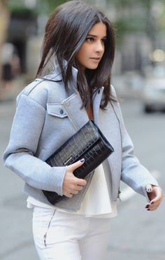 A cropped moto jacket over an all white outfit.