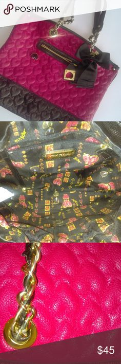 Betsey Johnson Dark Pink & BlackTote Betsey Johnson Dark Pink & Black Tote. There is wear on the chains. The inside and the outside look very good. Betsey Johnson Bags