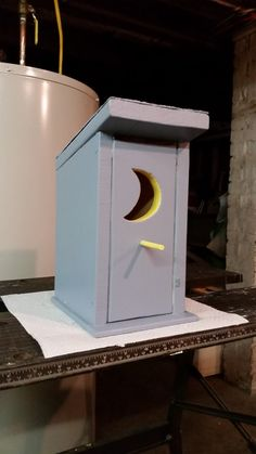 This Outhouse bird house is hand crafted out of pine lumber. Hand painted and detailed. (Gray and Yellow) Has a front entrance hole with perch. Note the moon shaped hole will allow small birds in. Front opens for easy access cleaning. Designed for the smaller bird family. The approximate size in inches. 6 W X 7 1/8 L X 11 H