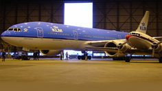 Old and new airliners under the hangar lights