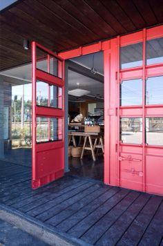 I like the modified shipping container doors here. Creative entry into shop space from design space - place to add strong splash of color. -gp
