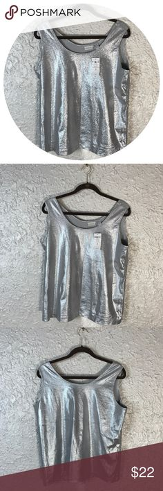 Chico's Silver Metallic Tank Top size 3 NWT Well, its shiny, it's new , and it's a tank top. NWT Nylon and Spandex size chart in photos Chico's Tops Tank Tops