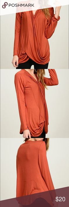 Orange Surplice Top So soft and comfy, this wonderfully draped top is in the color of the season. Made from 97% rayon/3% spandex. Bellino Clothing Tops
