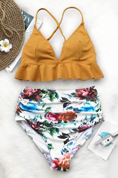 "This bikini set will get you plenty of attention. Product Code: AA10053M Details: Falbala design High-waisted fit With padding bra Regular wash Special fabric: 80% chinlon,20% spandex Reference:model try on SIZE M, height 5'8"", weight 150 lbs, bust 36C SIZE(IN) US UNDERBUST WAIST HIP S 4/6 25.2 23.6 29.1 M 8/10 26.8 25"