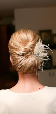Like something like this for the bridesmaids...feather hair accessory.