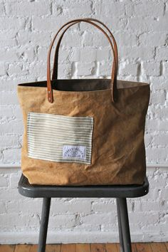 Bag measures approximately 16 in wide, 12 in tall, 4 in deep. Strap drop approximately 8 in.