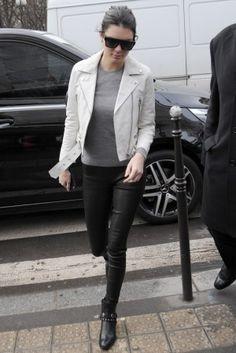 Kendall Jenner wearing Celine Cl 41756/S Zz-Top in Black, Acne Studios Mock Scratch White Leather Biker Jacket and Saint Laurent Wyatt 40 Concho Harness Ankle Boots