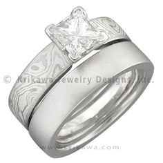 This is the most similar to how my ring will look when its done, but it will be plain, no embroidery looking thing on it and either silver or platinum.