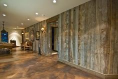 Barnwood walls and stained concrete floors. I'd like to see the floors either a couple shades lighter or darker than shown for better contrast.