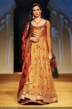 Sucheta Sharma walks the ramp to showcase a creation by designers Ashima and Leena on Day 4 of the India Bridal Fashion Week (IBFW) 2013 at The Grand, Vasant Kunj in New Delhi