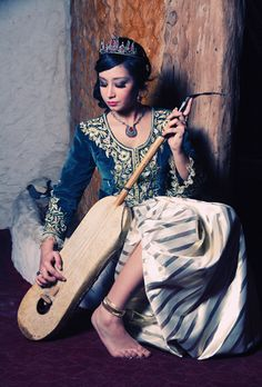 """Nowdays - Young woman wearing a """"karakou"""", the formal costume in Algiers tradition"""