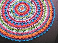Glinter´s circle Based on the free Flower Power Vest pattern by Lene Unmack Larsen. Would make a lovely cushion.