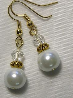 CYNTHIA LYNN DREAMY WHITE GLASS PEARL AB AURORA BOREALIS CRYSTAL GOLD PLATED EARRINGS 1.5 Matching necklace, bracelet, alternate earrings, and ring pictured are sold separately in my store. CYNTHIA LYNN DESIGN FROM THE WINTER COLLECTION ABOUT THE WINTER COLLECTION: Winter brings cooler temperatures, holiday festivities, and new beginnings. Look for pieces that celebrate the yuletide, and the winter wonderland - from clear and multicolor crystals to rich jewel tones. Step out in glamorous…