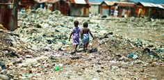 Two girls holding hands in Cite Soleil, Haiti