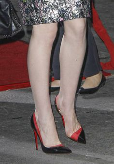 """Michelle Dockery wore black and red Christian Louboutin pumps to the Los Angeles premiere of """"Non-Stop"""" 