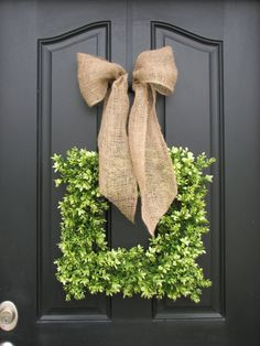 wreath + burlap bow - wow, this looks a lot like my wreath!  will have to try a burlap bow :)