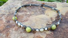Check out this item in my Etsy shop https://www.etsy.com/listing/518839716/hemp-choker-african-jade-shell-choker