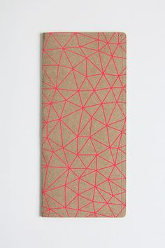 travel wallet made from ehavy duty kraft paper and screen printed with neon geometric pattern