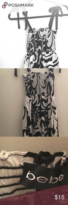 Black and white Bebe sundress - size M Cute sundress with ribbon tie straps and bandeau top. Very flattering fit. Length is just past the knees. Never worn, great condition. bebe Dresses Midi