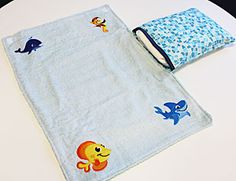 Embroidered changing pad with diaper caddy from the Embroidery Library.  Think how cute this would be with embroidered with colors from our baby gift palette.