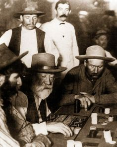 Judge Roy Bean (with white beard) gambling, 1889.