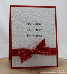 navy card, white background with stamped silver snowflakes, red ribbon, stamped words