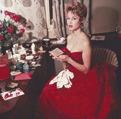 Brigitte Bardot wearing a gown by Christian Dior for a gala in Munich, Germany, 1957.