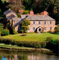 """St. Cadix is a real-life Georgian estate on a """"secret creek"""" off the River Fowey is the inspiration for Gideon Penrose's manor house in SMUGGLER'S MOON. I came upon it by accident while boating with Ciji Ware and friends, nearly 20 years ago, and never forgot it."""