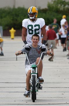 Green Bay Packer tradition of players riding kids bikes. (6)