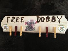 I made this for my boyfriend we both love Harry Potter! Wooden sign and clothes pins, wood burning pen, paint and decoupage the desired pics of dobby and hogwarts symbols! Took about 6 hours in 3 sittings :)