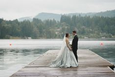 WOW! Romona Keveza bride Vanessa stuns in RK528 in Wedgewood Blue at her Vancouver wedding.