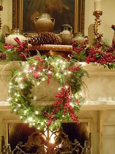 Christmas mantle with stacked books and pine cones. I love Christmas decorations and lights. Christmas Wreaths With Lights, Christmas Love, Beautiful Christmas, Winter Christmas, All Things Christmas, Christmas Crafts, Christmas Decorations, Holiday Decor, Lighted Wreaths