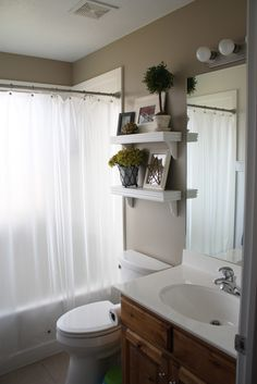I love the shelves above the toilet. Think I might try this for our house.