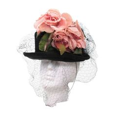 1950s Legroux Soeurs black silk hat with silk velvet roses | From a collection of rare vintage hats at http://www.1stdibs.com/fashion/accessories/hats/