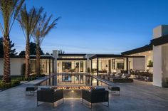 Reflecting a contemporary desert style, this Bali-inspired home was designed by Calvis Wyant Luxury Homes, located in Scottsdale, Arizona. - Luxury Homes Outdoor Fire, Indoor Outdoor, Architecture Durable, Fire Pit Designs, Desert Homes, Patio Heater, Swimming Pool Designs, Outdoor Kitchen Design, Contemporary Interior Design