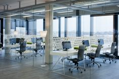 this goes with my idea of inverse enclosure. rather than enclose conference rooms etc put all the staff into glass boxes
