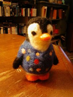 This little needle felted  penguin nurse is wearing happy scrubs! 9/10/13 made by Jamie Malley